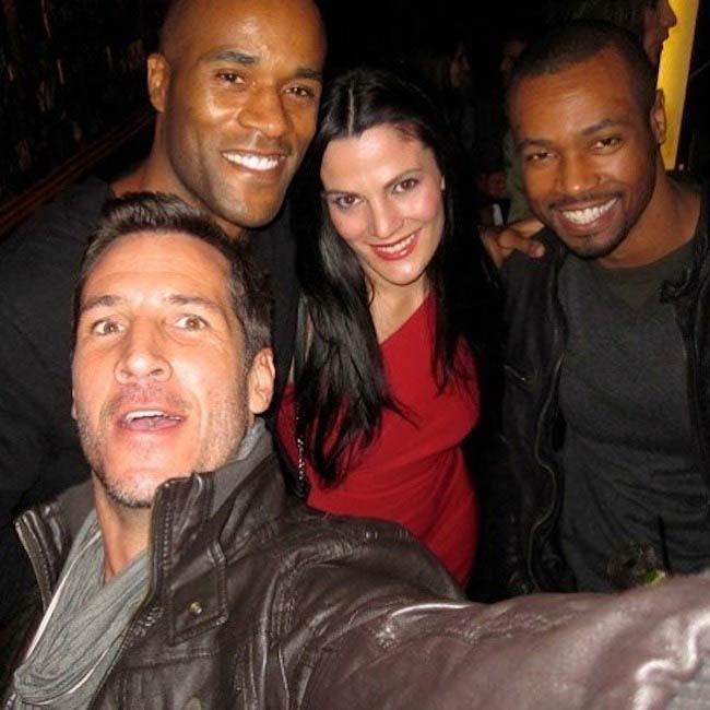 Isaiah Mustafa with realtor Mina Ivanova Garrett (in red dress), Dustin Dennard (Front), and actor LaMonica Garrett (Left) in March 2018