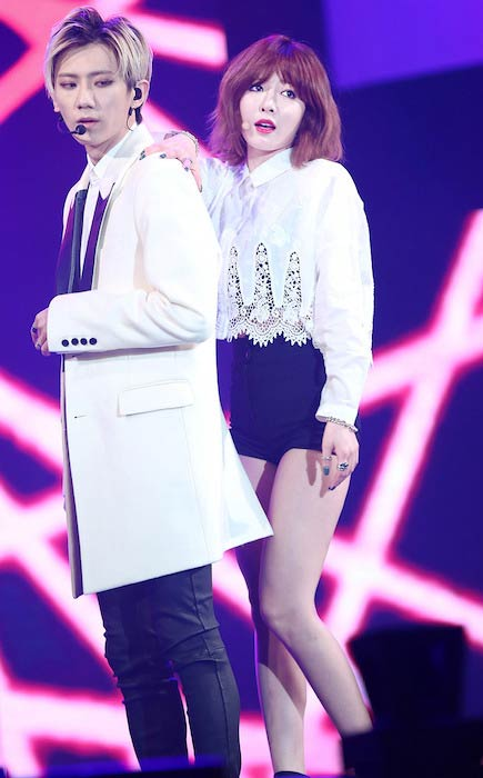 Jang Hyun-seung and Hyuna of Trouble Maker performing at V-Pop Festival Concert in January 2014