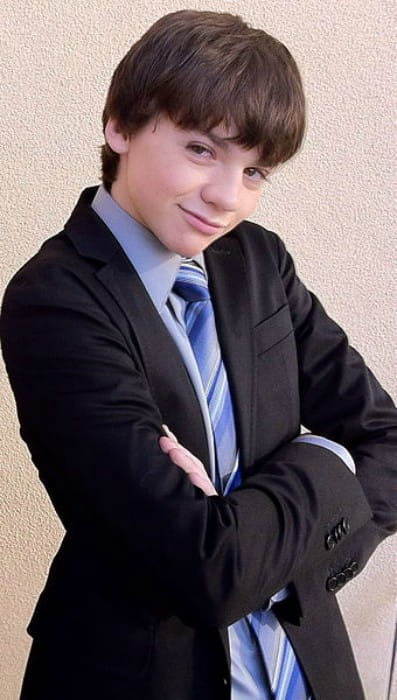 Joel Courtney at a red carpet event in January 2012