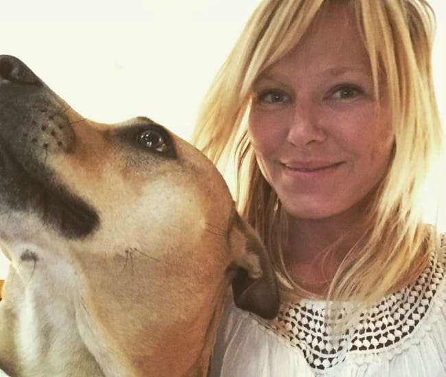 Kelli Giddish with her dog as seen in June 2017