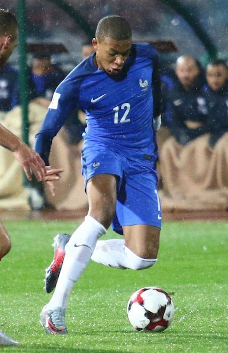 Kylian Mbappé in action in a football match in October 2017