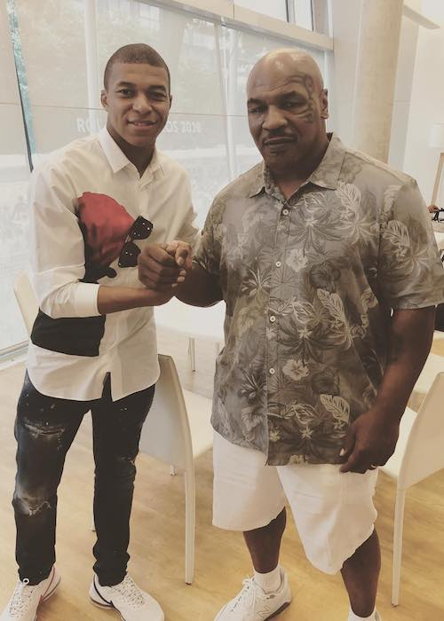 Kylian Mbappé with former boxer Mike Tyson