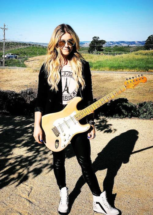 Lindsay Ell with her guitar at Liana Estates in May 2018