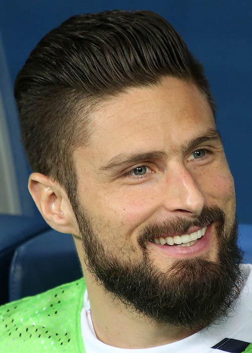 Olivier Giroud smiling after winning the match against Russia in 2018