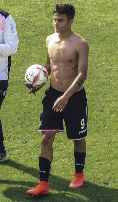 Paulo Dybala shirtless on football ground in May 2015