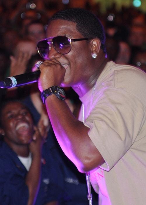 Rapper Yung Joc performing in a concert aboard the aircraft carrier USS Dwight D. Eisenhower (CVN 69) in April 2009