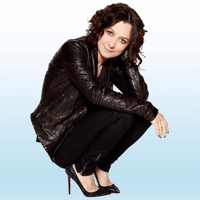 Sara Gilbert in a crouched pose in December 2014
