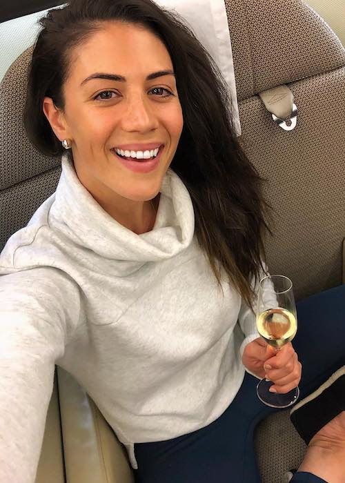 Stephanie Rice on Qantas airlines having a drink in April 2018