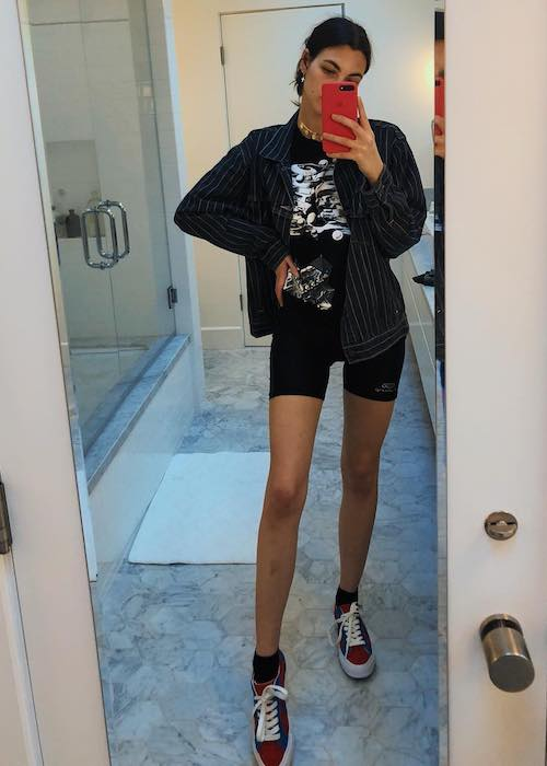 Vittoria Ceretti in June 2018 mirror selfie showing her long slender legs