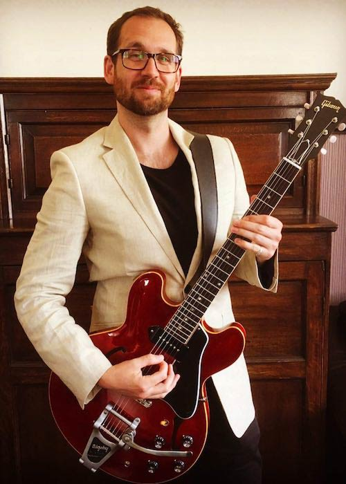 Will Farquarson wearing linen jacket and playing Gibson 330 guitar in May 2017