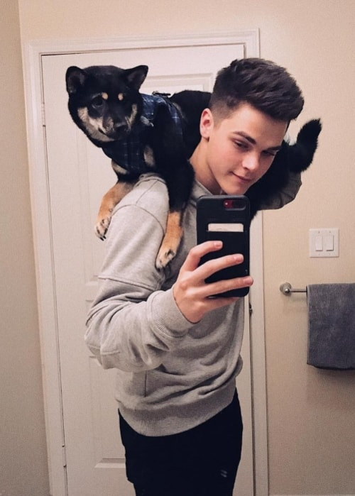 AJ Mitchell in a mirror selfie with his dog in March 2018