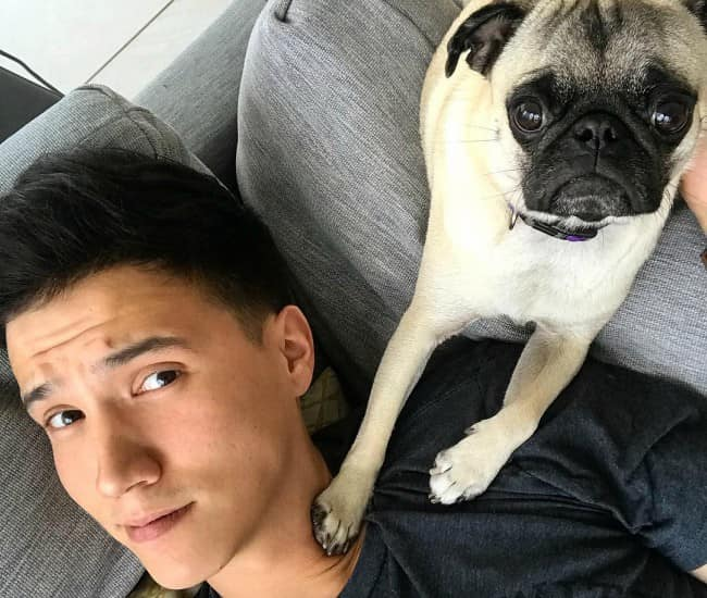 Aaron Burriss in a selfie with his dog as seen in May 2018