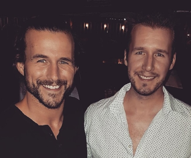 Adam Cole (Left) with his younger brother Brent Jenkins in July 2017