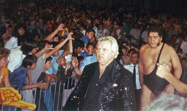 """Andre the Giant walking with his manager Bobby """"The Brain"""" Heenan in the 1980s"""