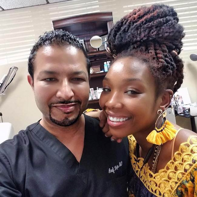 Brandy Norwood with cosmetic surgeon Dr. Aref Bhuiya in February 2018
