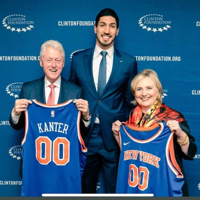 Enes Kanter (Centre) with Bill Clinton and Hillary Clinton in June 2018