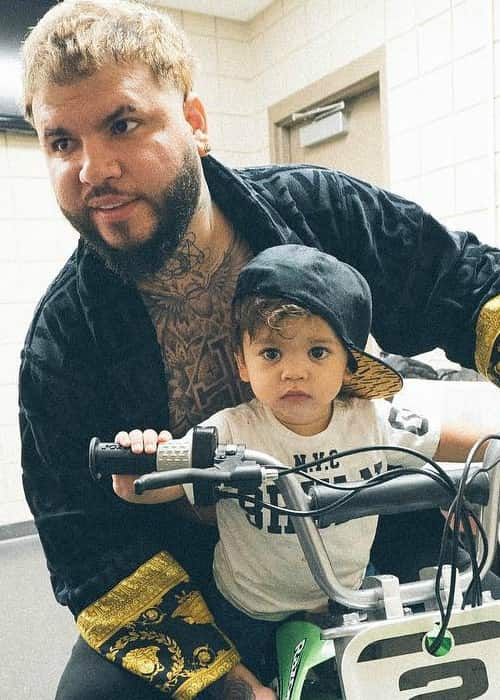 Farruko in an Instagram post with his son as seen in May 2018