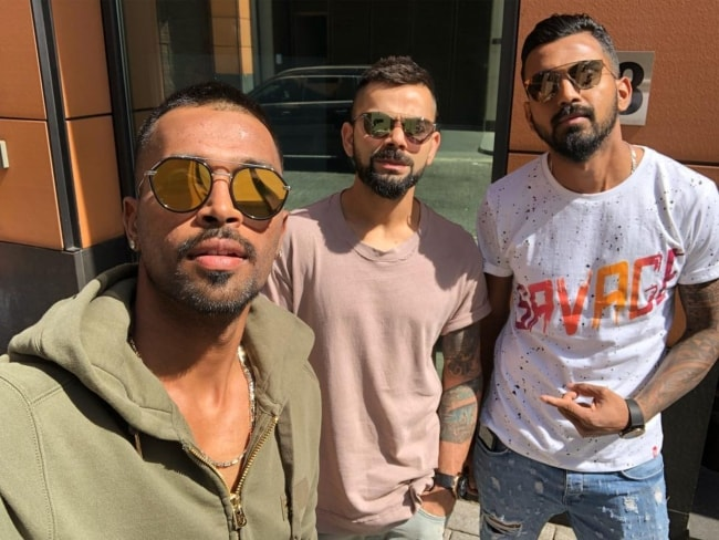 Hardik Pandya (Left) with Virat Kohli and K.L. Rahul (Right) as seen in June 2018