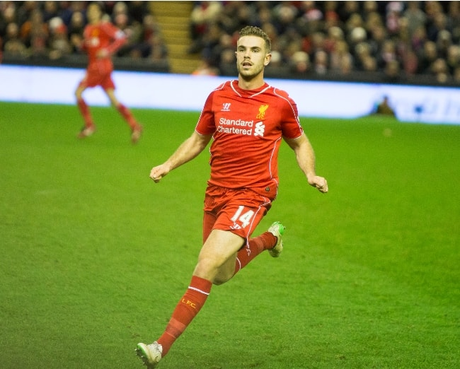 Jordan Henderson while playing for Liverpool F.C. against Arsenal in a Premier League match in December 2014