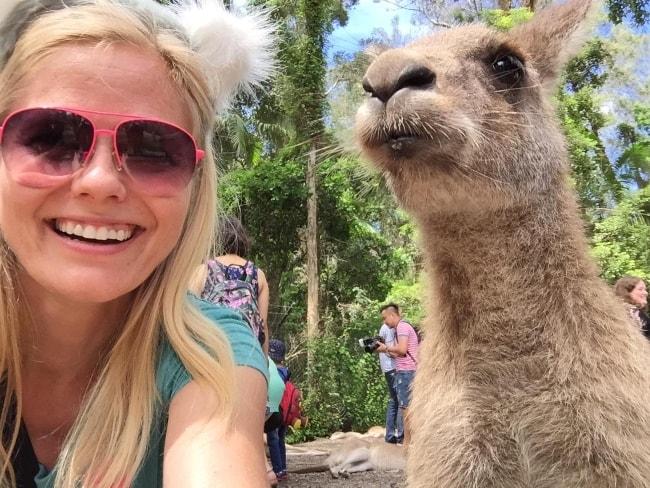 Meghan McCarthy in a selfie with a kangaroo in February 2015