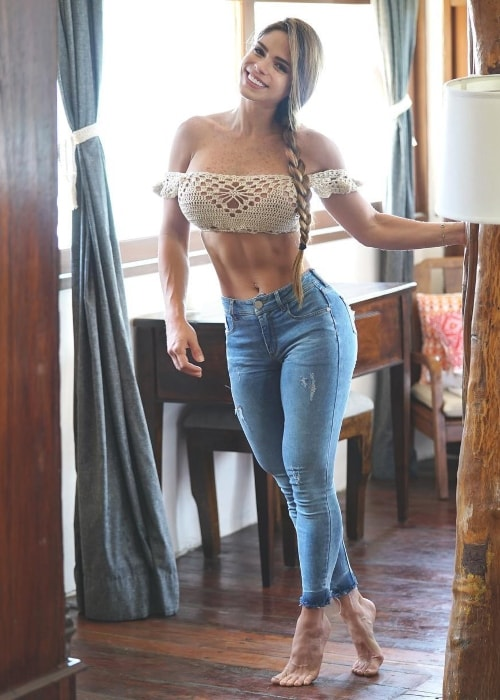 Michelle Lewin sporting a wide grin in a picture in May 2018