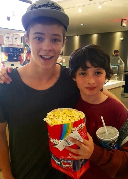 Nicholas Hamilton (left) with Finn Wolfhard (right) in December 2016