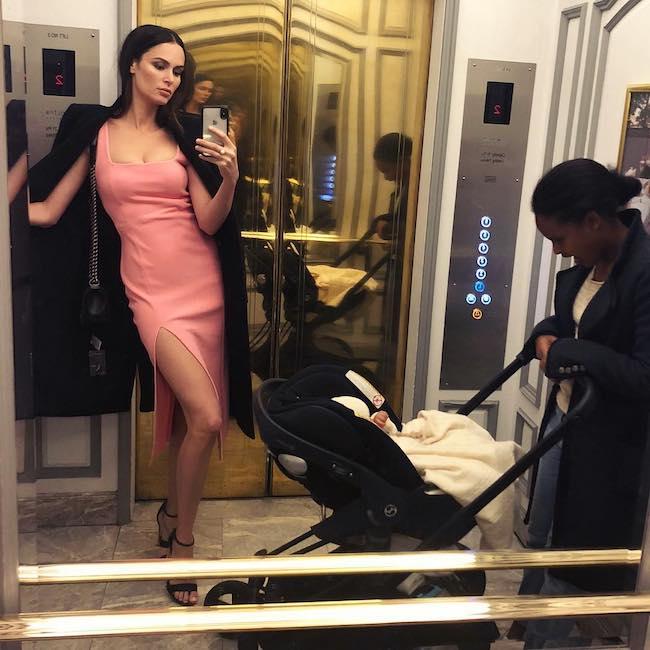 Nicole Trunfio in a mirror selfie inside the elevator in July 2018