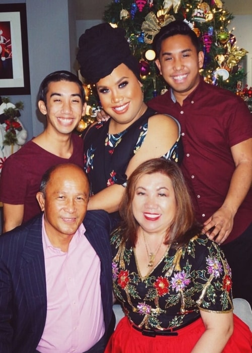 Patrick Starrr posing with his family in December 2016