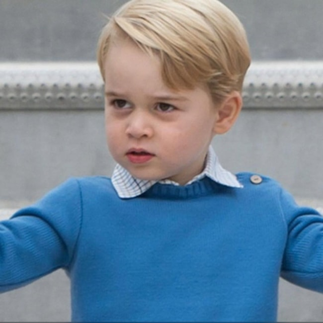 Prince George sporting a blue attire
