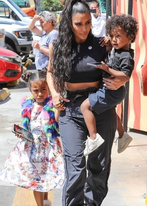Saint West with mother Kim Kardashian West and older sister North