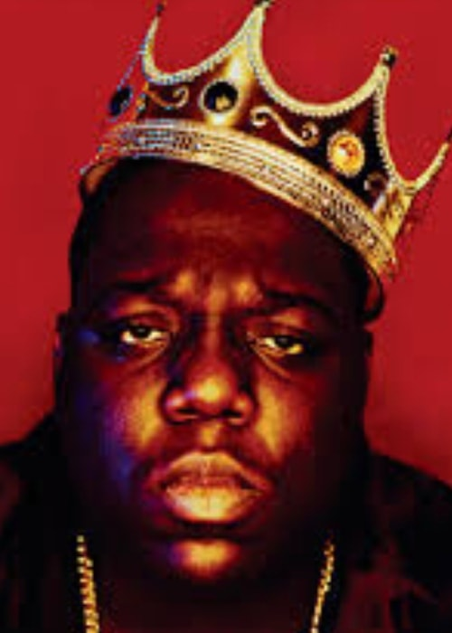 The Notorious B.I.G in a king-like pose
