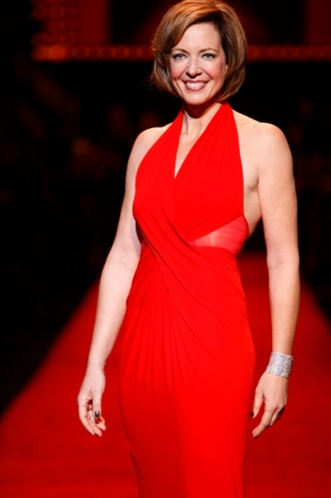 Allison Janney in a stunning red dress at The Heart Truth Fashion Show in February 2008
