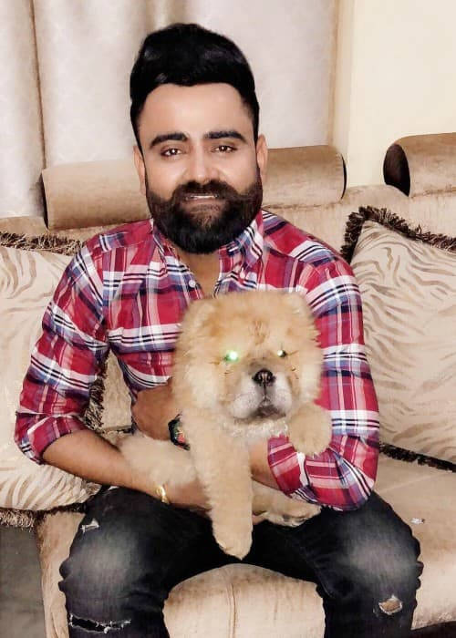 Amrit Maan with his pet dog as seen in March 2018