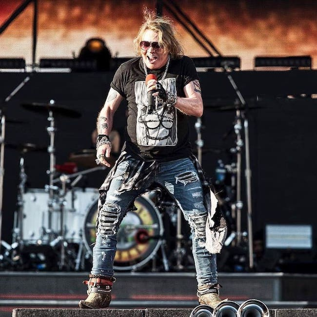 Axl Rose of Guns N' Roses giving a performance during a concert