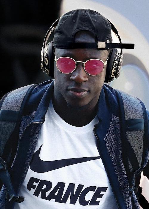 Benjamin Mendy looks dapper while listening to songs and wearing Nike t-shirt in July 2018