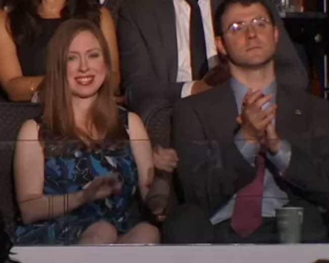 Chelsea Clinton with Marc Mezvinsky while listening to Bill Clinton's speech in 2016