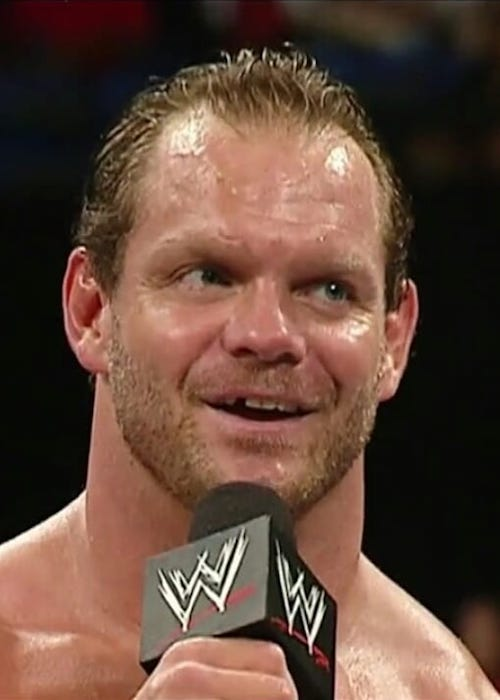 Chris Benoit while talking with fans inside the ring