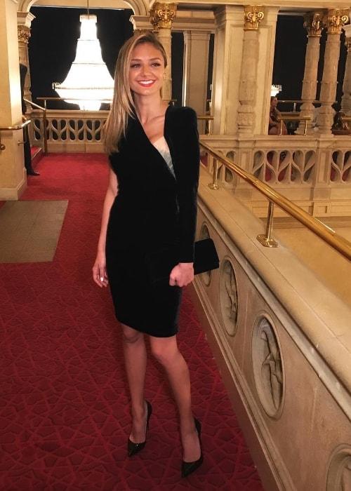 Christine Evangelista in a stunning black dress in April 2018