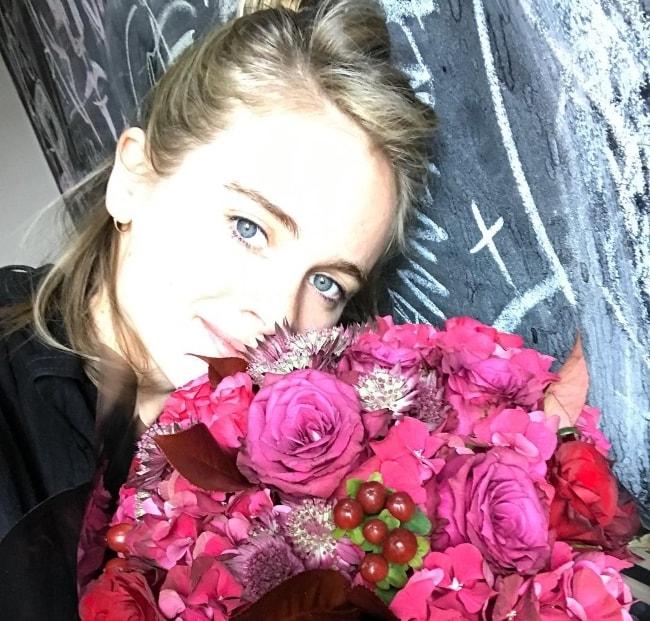 Cressida Bonas in an Instagram selfie with a bouquet in June 2017