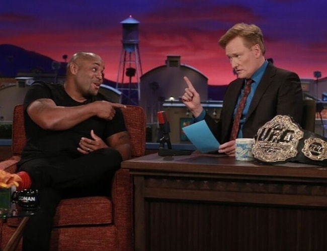 Daniel Cormier (Left) at Conan O'Brien's talk show