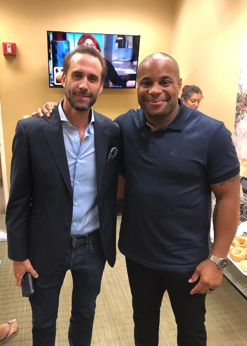 Daniel Cormier with Joseph Fiennes in July 2018