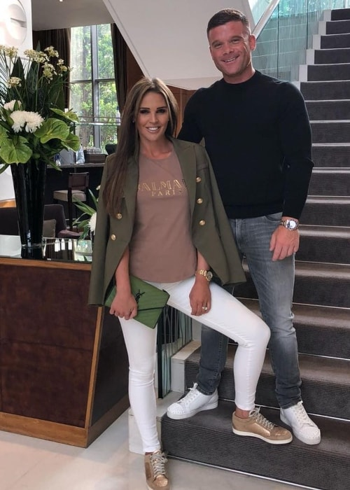 Danielle Lloyd at Canary Riverside Plaza with Michael O'Neill in June 2018
