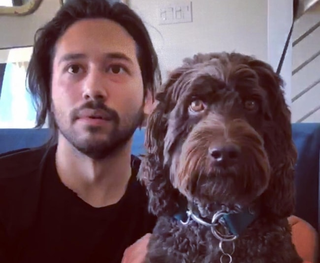 Jesse Rath with his dog in June 2018