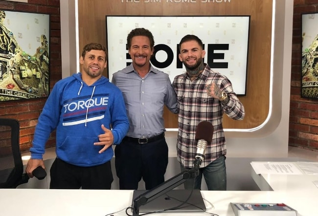 Jim Rome with Cody Garbrandt (Right) and Urijah Faber (Left) in May 2018