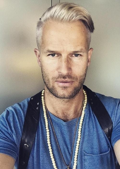 Johann Urb sporting platinum blonde hair in a selfie in May 2018
