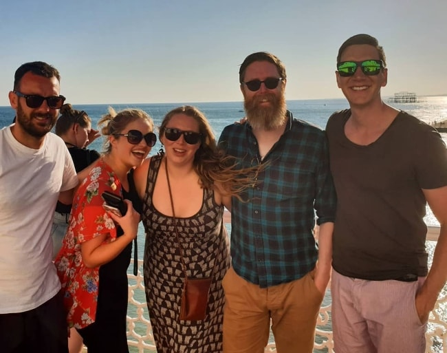 Oliver Phelps (Corner Right) at the seaside with his friends in June 2018
