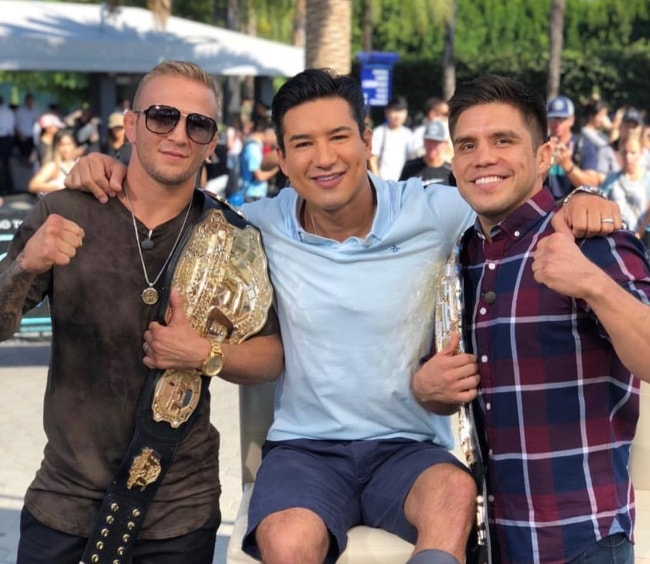 TJ Dillashaw (Left) with Mario Lopez and Henry Cejudo (Right) at Universal Studios Hollywood in August 2018