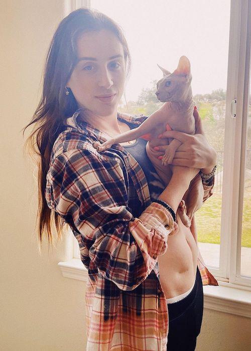 Trevi Moran holding her cat named Poppy in March 2021
