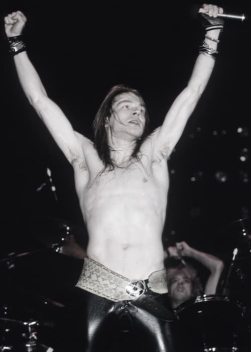 Young Axl Rose showing his shirtless body