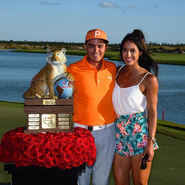 Allison Stokke and Rickie Fowler with the trophy at Hero World Challenge in December 2017